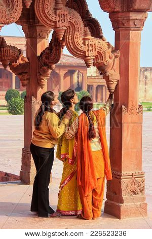Fatehpur Sikri, India-jan 30: Unidentified Women Stand In Astrologer's Kiosk On January 30, 2011 In