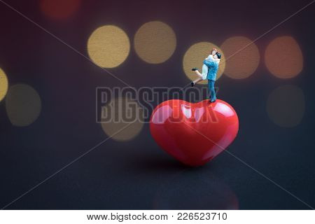 Wedding Sweet Romantic Night Concept, Happy Miniature Couple Holding And Standing On Red Heart Shape
