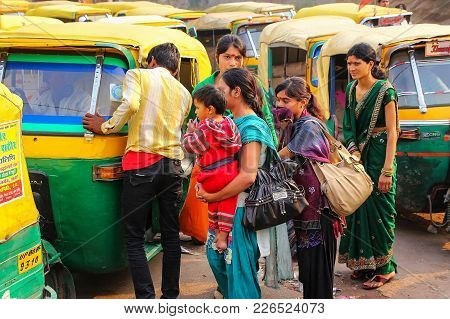 Agra, India - November 10: Unidentified People Wait For A Tuk-tuk At Kinari Bazaar On November 10, 2