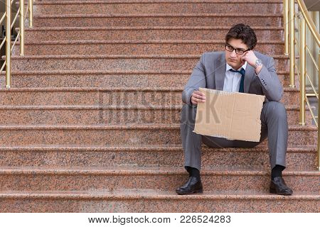 Desperate businessman begging on the street