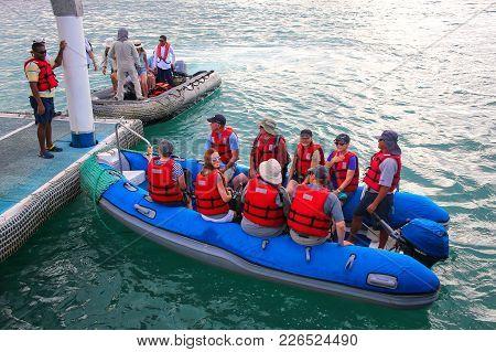 Santa Cruz Island, Ecuador - April 23: Unidentified People Sit In A Dinghy At Puerto Ayora On Santa