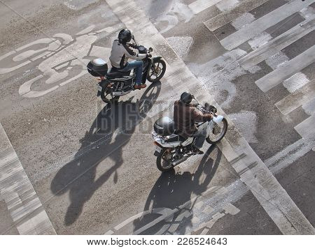 Mexico City, D.f. / Mexico - January 09 2016: Two Men Riding Motorcycles On The Street In Mexico Cit