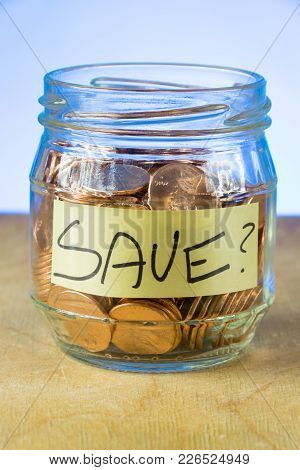 Why Save? A Shot Of A Small Jar Of American Pennies With The Word