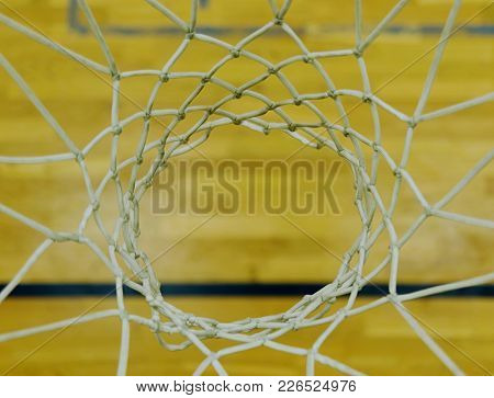 Look Down Through White String Net, Hardwood Basketball Board With Black Line. Basketball Hoop In Th