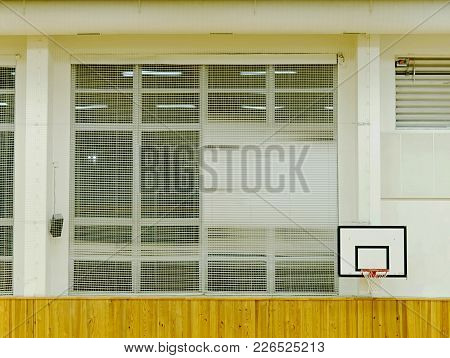 Basketball Hoop On The Wall.  Empty Basketball Court. The School Sporting Hall