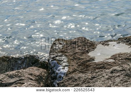 A Shot Of Rocks Submerged In Water.