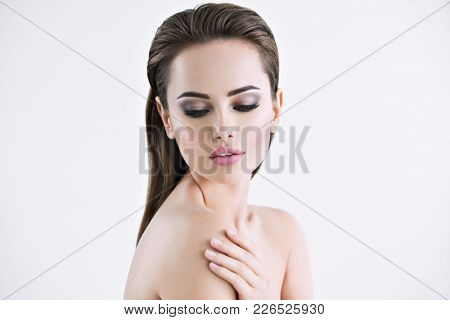 Photo of a beautiful young girl with beauty face  - isolated on white.  Skin care concept.