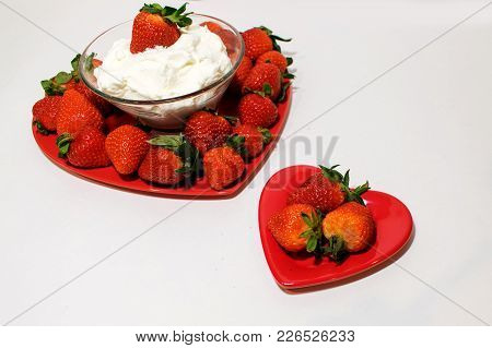 One Large Heart With Strawberries And Whipped Cream And Beside It Another Smaller Heart Plate With A