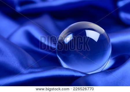 glowing crystal ball shot on blue satin
