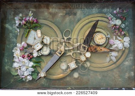 Pair Of Antique Big Scissors, Intertwined With Arms Into Each Other On A Copper Plate Surrounded By