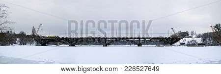 Frozen River Southern Bug And The Kiev Bridge In A State Of Reconstruction (ukraine, Vinnitsa, 2018)