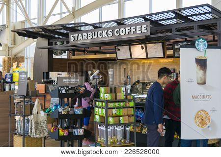 People Buying Coffee From Starbucks
