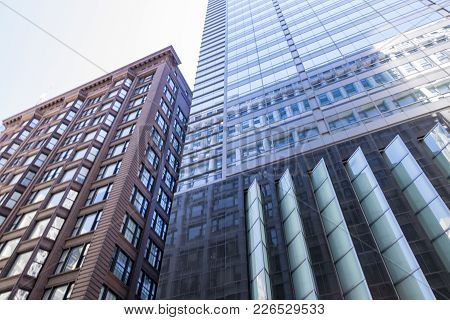 Shot Taken Looking Up Toward Two Tall Buildings In Chicago, Illinois.