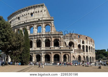 Rome, Italy - June 23, 2017: People In Front Of  Colosseum In City Of Rome, Italy