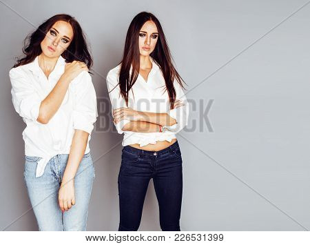 Two Sisters Twins Girl Posing, Making Photo Selfie, Dressed Same White Shirt, Diverse Hairstyle Frie