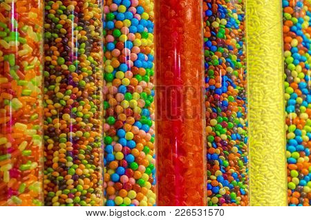 Shot Of Plastic Containers Filled With Sugary, Colorful Handy Candy.