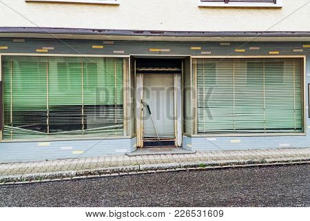 Closed Bankrupt Shop With Closed Blinds. Outdoor
