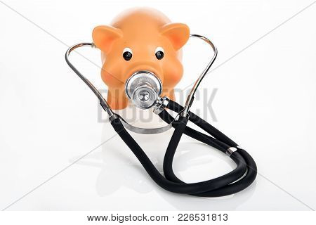 Piggybank With Stethoscope On Bright Background- Concept Expansive Healthcare