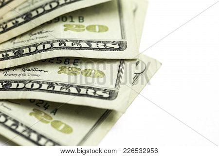 Twenty 20 Dollar Bills Shot Against A White Background