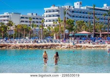 Ayia Napa, Cyprus - April 04, 2016: People Relaxing And Sunbathing Nissi Beach On Sunny Day.