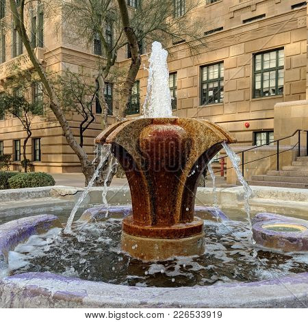 Streaming Down Water Coming Out Of Decorative Fountain Built Next To Historic Building In Phoenix Do