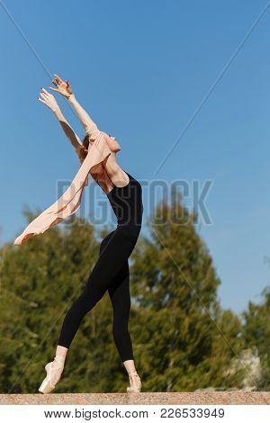 A Young Slender Ballerina Dances Outdoors. Beauty And Grace Of The Body. Ballet Pas. Street Performa