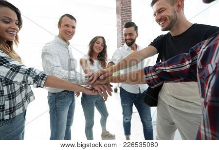 creative business team with hands clasped together
