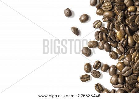 Coffee Beans Shot Close Up With A Macro Lens On A White Background