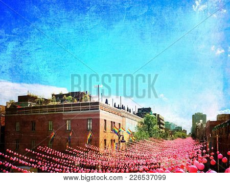 Retro Style Image Of A Street In Gay Neighborhood Decorated With Pink Balls. Annual Summer Installat