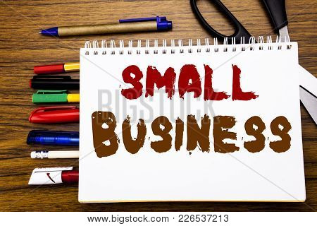 Word, Writing Small Business. Business Concept For Family Owned Company Written On Notebook, Wooden