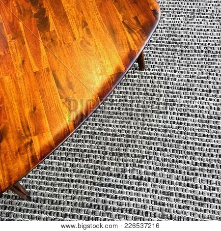 Wooden Table On Gray Rug. Modern Design With Retro Feel.