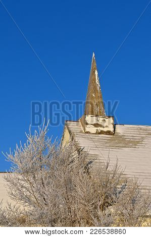 An Old Wood Steeple Of A Church Is In Need Of Fresh Paint.