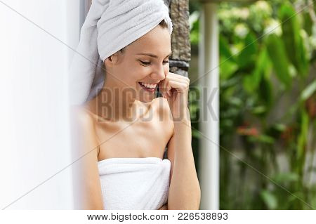 Youth, Happiness, Beauty And Lifestyle Concept. Beautiful Glad European Woman With White Towel Bun S