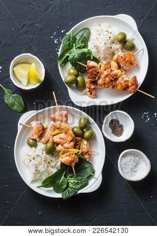 Salmon Skewers, Olives, Spinach, Rice - Healthy Lunch Table. Grilled Salmon Fish Skewer And Side Dis