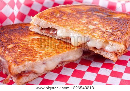 Decadent Grilled Cheese And Bacon Sandwiches With Oozing Cheese Running Out With Ketchup For Dipping