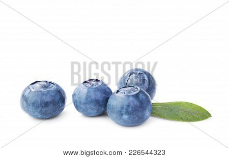 Fresh Blueberries With Leaves Isolated On White Background. Macro Shot