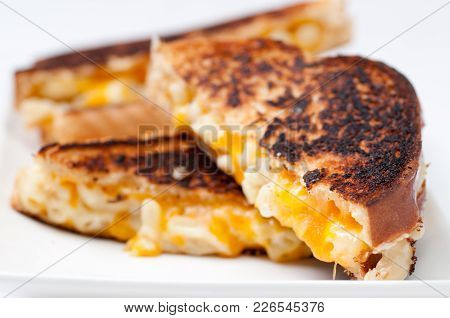 Decadent Mac And Cheese Sandwich With White And Orange Cheeses