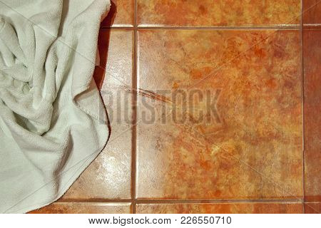 Copy Space. Wet Creased White Towel On Ceramic Floor In Bathroom. Ceramic Tile Warm Colors. For Back