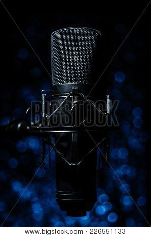 An Isolated Vocal Microphone With Background Bokeh