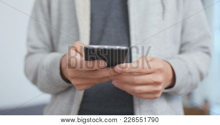 Man use of mobile phone close up