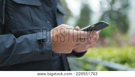 Man use of mobile phone at outdoor