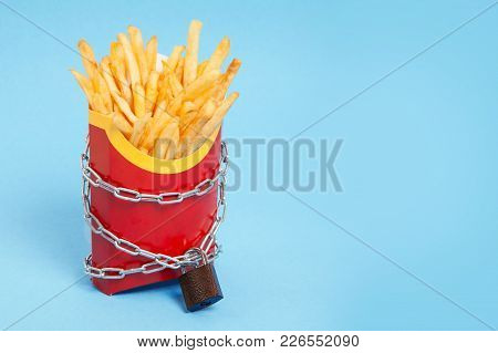 Ban On Potatoes For Diet And Cholesterol Reduction. The French Fries In The Packing Box Are Wrapped