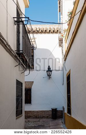 Old Typical Narrow Street In The Jewish Quarter Of Cordoba With Old Buildings With White Walls Decor