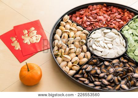 Traditional Chinese snack tray with red packet word mean luck