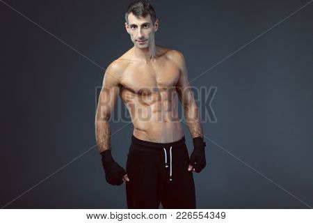 portrait of hand wrapping half nude boxer.