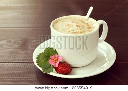 Frothy Coffee With Whipped Milk In Cup Is Decorated With Real Berries Of Fresh Strawberries With Flo