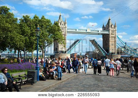 LONDON, UK - JUNE 7, 2017:  Tower Bridge is an iconic bridge in London built  between 1886 and 1894 and open for a passing ship twice a day and its totally free of charge.