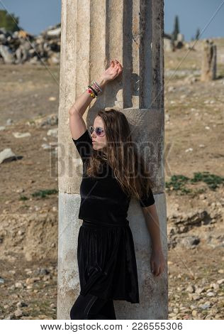 Beautiful Greek Young Girl Holding An Ancient Vessel In Ancient Theatre Of Thassos Island, Greece.