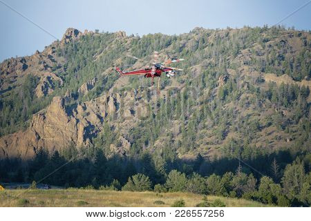 Fire Fighting Helicopter Approaching Water Supply For Forest Fire