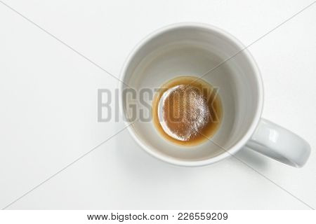 Isolated White Mug With Coffee Residue At Bottom